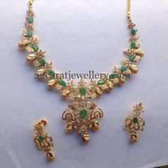Jewellery Designs: CZ Necklace with Gold Color Pearls