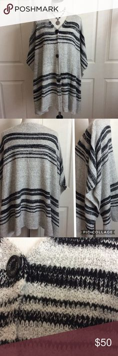 NWT Stretch Knit Wrap Poncho Chunky stretch knit oversized poncho . Unbelievably soft & cozy!  Large arm holes & 3 buttons down the front. Excellent new condition. Labeled S/M but, imo, one size fits all. Vertigo Paris Sweaters Shrugs & Ponchos