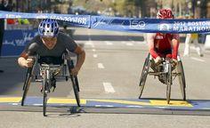 Shirley Reilly (L) of the U.S. ducks under the tape to win the women's wheelchair division of the 116th Boston Marathon ahead of Wakako Tsuchida of Japan in Boston, Massachusetts.