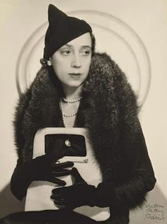 "Elsa Schiaparelli wearing her ""mad cap"" design. Photo courtesy christies.com"