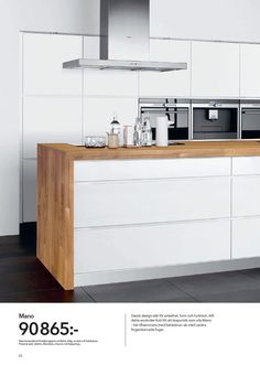 Natural timber bench top with clean, white cabinetry.