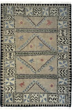 """Kilimanjaro (khaki) by A Rug For All Reasons   This is one of those rugs that """"you just have to see""""! It's stunning in person and a wonderful design for so many homes where the owners would like something that's warm and inviting and not formal. Graced with birds, suns and geometric shapes."""