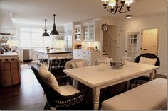 loves: open layout, bench seating at table, hanging wall clock, giant work island, farmhouse kitchen sink