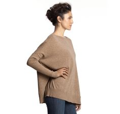 Super simple. A basic blanket + arms from existing sweater= this. Cozy/chic.