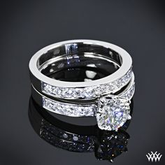 "Captivating and bold, this tiffany style ""Bead-Set"" Diamond Wedding Set is proof that good things come in twos. The tiffany style ""Bead-Set"" Diamond Engagement Ring is beautifully crafted and holds 10 magnificent A CUT ABOVE® Hearts and Arrows Diamond Melee, while the gorgeous matching tiffany style ""Bead-Set"" Diamond Wedding Ring shines with 12 A CUT ABOVE® Hearts and Arrows Diamond Melee"
