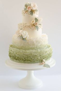 Ombre ruffled wedding cake, love the colors.