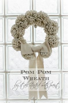 """Anthropologie-inspired pom pom wreath""  It doesn't really matter to me *who* inspired it, I love it because it reminds me of my roller-skates when I was young. I used to make pom-poms to  coordinate with my boot covers.  Does this sound familiar to anyone?  Or maybe I'm just a nerd... Or, maybe, the people at Anthropologie were inspired by my pom-pom clad roller-skates... Maybe... ;o)"