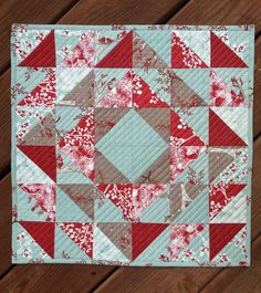 Winterberry Table Topper - VERY CUTE - and pattern can easily be enlarged and fabric changed to make baby, patriotic, or many other quilts!