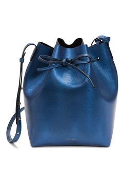 Fashion | bucket bag in metallic blue • Mansur Gavriel teaming up with Colette for an exclusive version of their best - selling bag