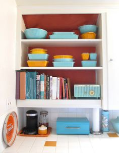 Perfect idea for the one cabinet to the left of the kitchen sink. Just enough open cabinet to show off the goods :)