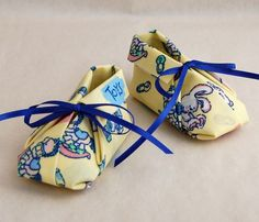 fabric origami booties.  I just found the diagrams for these ... why couldn't I have seen this a month ago when we had a baby shower for a coworker!  : (