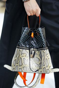 Kenzo Spring 2017 Menswear Collection - Vogue, snakeskin print bucket bag by Kenzo with orange handle and color blocking details, snakeskin pattern leather bag Burberry Handbags, Chanel Handbags, Burberry Bags, Chanel Bags, Designer Handbags, Fashion Bags, Mens Fashion, Sacs Design, Bowling Bags