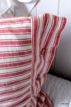 Red and white ticking pillows