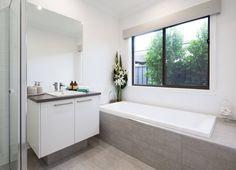 white cupboards, darker top, light floor  Metricon / bathroom tiles