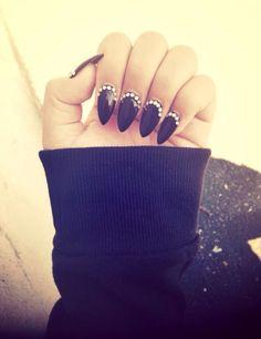 Black, pointy nails with diamonds / gems / rhinestones