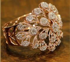 Best Diamond Bracelets : This amazing rendition of chrysanthemum flower crafted with the brilliant cut d Jewelry Design Earrings, Gold Rings Jewelry, Wedding Jewelry, Jewelry Sets, Silver Jewellery, Wedding Ring, Fancy Jewellery, Gold Jewellery Design, Fashion Rings