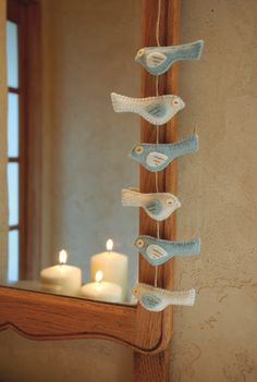 Little Birds Garland.  I think this would be sweet to string nose to tail and hang on my Christmas tree.