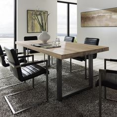 Image from http://diningouticeland.com/wp-content/uploads/2014/05/modern-wood-dining-table-with-metal-legs-325.jpg.