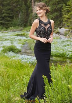 Look sophisticated and sexy in Morilee prom dress 99152. This elegant dress displays an illusion neckline with intricate beading along the bodice. The jersey material will flatter your figure and feel comfortable throughout the night. The back features beautiful beadwork running down the center of the back, and a back cut out. Find this dress at Peaches Boutique.