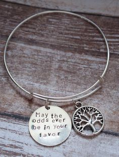Hunger Games Adjustable Bracelet by TheCharmingBumblebee on Etsy