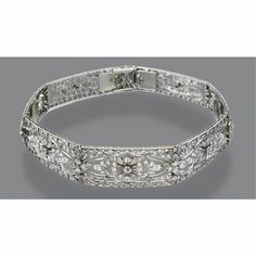 Diamond choker/bandeau, circa 1910. The hinged band designed as a series of panels graduating in size, each decorated centrally with a floral medallion in an openwork quatrefoil frame with old European-cut, old-mine and single-cut diamonds approx. 9 carats, mounted in platinum, length 12½ inches; together with a pair of detachable hairpins.  (Sotheby's)