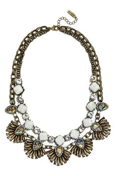 This sparkly antiqued bib necklace features seafoam green and iridescent crystals to create rippling waves of shimmer.
