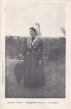 Woman in Poitevin costume showing belt hook being worn