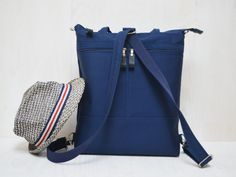Items similar to Navy Canvas Messenger Bag, Minimalist Backpack, Convertible Crossbody Zipper Bag, Vegan Functional Bag, Zipper Laptop Bag on Etsy Tote Backpack, Drawstring Backpack, Fashion Backpack, Canvas Messenger Bag, Canvas Backpack, Holiday Canvas, Minimalist Bag, Birthday Gifts For Her, Zipper Bags