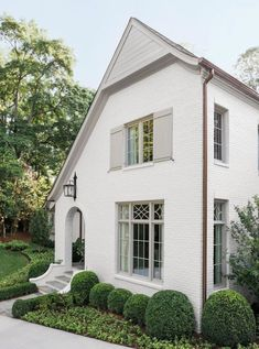 White brick home with arched entrance and light gray trim and shutters - Ladisic Fine Homes & Sherry Hart.. #benjaminmoore #balboamist #intellectualgray #houseexterior #paintcolors White Exterior Paint, White Exterior Houses, Exterior Paint Colors For House, Grey Exterior, Cottage Exterior, Exterior Design, Exterior Homes, White House Exteriors, Stucco House Colors