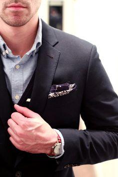Navy blazer with bandana as pocket square, vest and light blue denim shirt