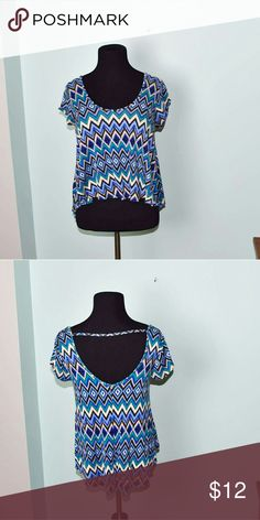 Gorgeous Blue Zigzag Print Flowy Blouse In excellent condition! Very flattering, stretchy, and soft! Buy 3 items and get 1 free plus 15% off your purchase total! Tops Blouses