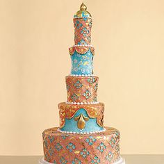 Tall tiers in rich jewel tones evoke an East Indian motif. Chocolate blackout cake filled with chocolate toffee-crunch ganache, covered with sugar-paste and decorated with gold leaf and hand-painted flowers, by Margaret Braun, margaretbraun.com. Photo: Miki Duisterhof