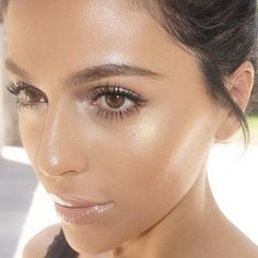 A dewy glow and nude lipgloss will help you get a fresh-faced look!