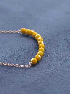 Vintage Yellow Beaded Necklace - Bead Bar Necklace - Delicate Faceted Beads on Gold Filled Chain - Yellow Necklace. $23.00, via Etsy.