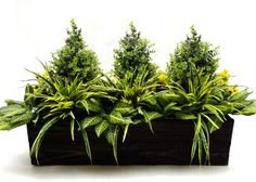 Artificial greenery window box. Add some color and texture to you homes exterior with this beautifully planter trough. Can be customized to your dimensions. Click for more information