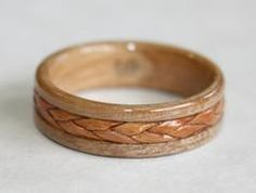 Just to add some perspective for all the ladies out there. My idea of a beautiful engagement ring. Diamonds are a hoax. Braided Birch Bark inlaid on an Apple Wood Ring, Touch Wood Rings