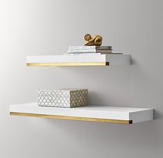 RH Baby & Child's Metal-Trimmed Floating Wood Shelf - White:Metal trim along the bottom of our cantilevered shelf adds a midcentury modern aesthetic to warm wood construction. Mounts flush to the wall for a streamlined display. Gold Shelves, Wooden Shelves, Wood Shelf, Wall Mounted Shelf, White Wall Shelves, Modern Floating Shelves, Shelves In Bedroom, Metal Trim, Tin Metal