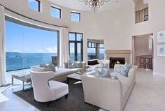 Contemporary Living Room with French doors, Transom window, Chandelier, High ceiling, Loft
