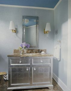 Vanity sheathed in silver leaf via House Beautiful. Designed by Sally Markham.