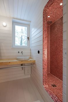 Penny Shower Stall The architects continue to play with the lining of surfaces and edges as the shower tiles spill out to line the frame of the opening. waldhaus-by-atelier-st-in-leipzig-bathroom Bad Inspiration, Bathroom Inspiration, Ideas Baños, Red Tiles, Mosaic Tiles, Penny Tile, Forest House, Tree Forest, Beautiful Bathrooms