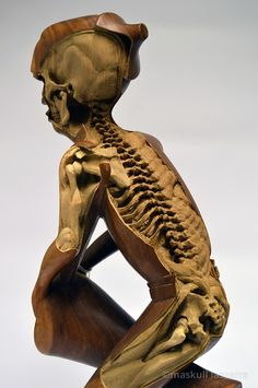 """Artist Maskull Lasserre acquired a number of souvenir sculptures, the kind found in antique stores or craft fairs that have been mass-produced by anonymous artists, which he then used as a foundation for his own artwork. In a process he refers to as """"re-carving,"""" Lasserre removed details from the artist's original work to reveal intricate skeletal structures."""