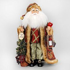 The Lighted Wine Tree Santa from Karen Didion Originals brings the joy of Christmas into your home. The quality of this figurine is unmatched with its hand-painted face, glass inset eyes, real mohair beard, unique fabric, and detailed accessories.