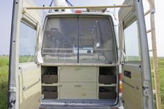 Rear-door bug screen in Peter's Sprinter conversion.