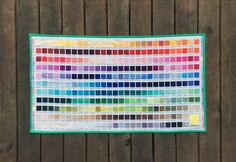 Decorate your sewing room with this Kona Cotton Digital Printed Color Chart for inspiration or reference! Click for the mini quilt tutorial.