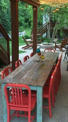 Red chairs and teal distressed farm table