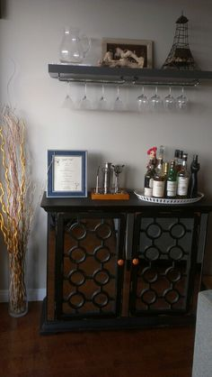 Pinterest inspired DIY	bar shelf. Ikea shelf, home depot wine brackets.