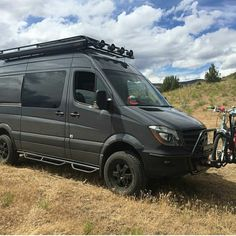 Exclusive Outfitters rig with Aluminess roof rack, nerf bars and light bar