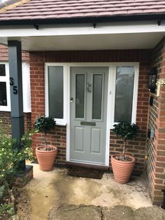 The Ludlow in Painswick Kings Avenue, Traditional Front Doors, Window Company, Painted Front Doors, Entrance, Garage Doors, Exterior, Windows, Outdoor Decor