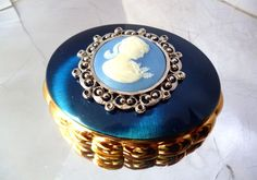 Vintage Kigu Concerto Blue Enamel Musical Compact Wedgwood Cameo Inset Gold Tone Oval Compact Mirror Box NOS 1960's Bridal Bridesmaid Gift by JustSparkles on Etsy https://www.etsy.com/listing/502744815/vintage-kigu-concerto-blue-enamel