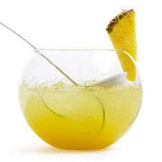 Pineapple Ginger Punch - With or without booze. Don't just spike the punch -- electrify it with an infusion of sweet pineapple rum and zesty citrus juices. Slices of fresh ginger give it a spiced spin. Sangria Cocktail, Lemonade Cocktail, Wine Cocktails, Non Alcoholic Drinks, Cocktail Recipes, Drink Recipes, Vodka, Tequila, Summer Drinks